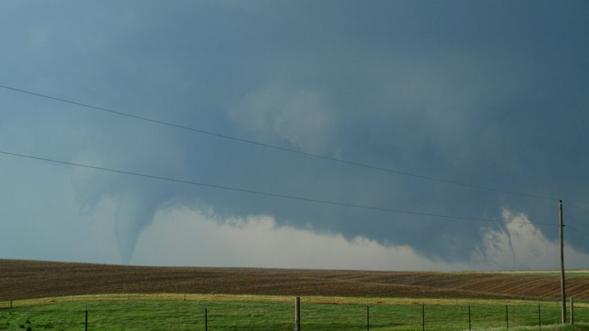 Figure 5: The lower vortex becomes multi-vortexed, dropping sister tornadoes. Three tornadoes are visible on the ground