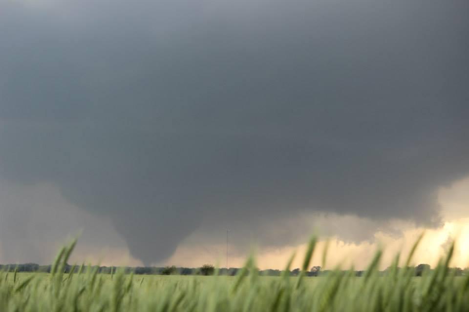 The wedge tornado still just west of Bennington, KS beyond a wheat field. Photo by Andrew Schuler.