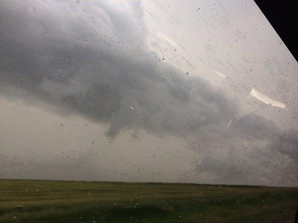 Figure 1: A shelf cloud overtakes the van in Otis, KS
