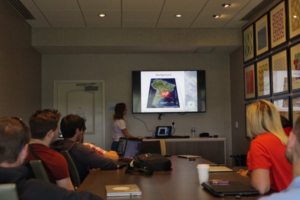 Figure 1: Flavia Moraes presents her thesis defense to the WKU Storm Chasers