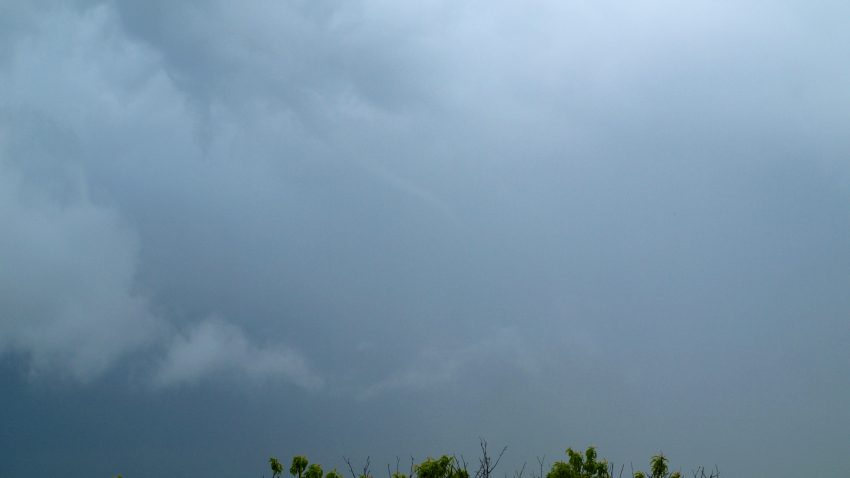Figure 2: A thin, ropy funnel descends from a rotating wall cloud in Belleville, KS
